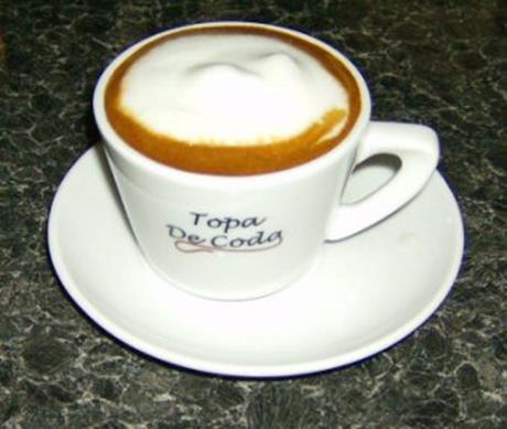 Traditional Cappuccino coffee served in Topa De Coda branded cups